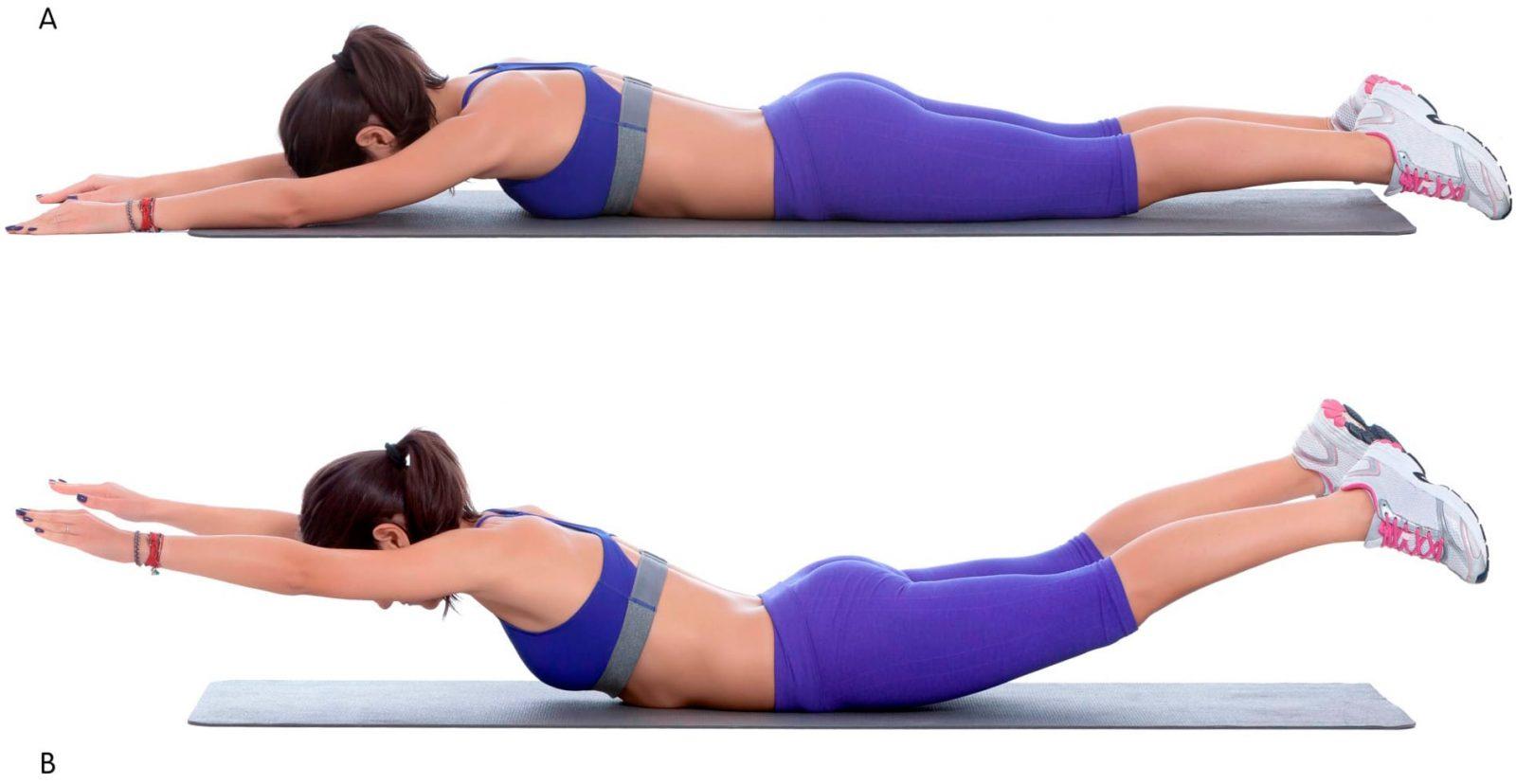 Девушка выполняет лежа на полу одновременный подъем рук и ног на животе
